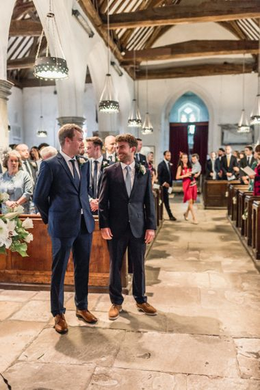 Groom and Best Man Standing at the Altar