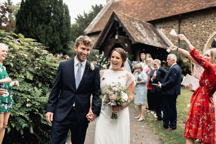 Confetti Moment with Bride  in Charlie Brear Torum Wedding Dress and Groom in Navy suit