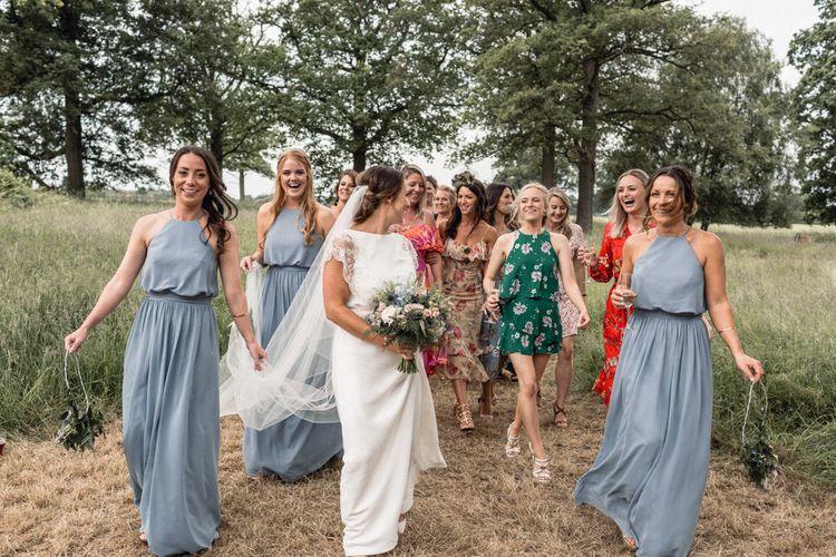 Bride  in Charlie Brear Torum Wedding Dress with her best girls including her Bridesmaids in Blue JJ's House Dresses