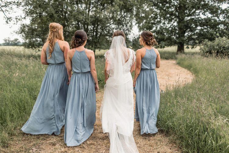 Bride in Charlie Brear Torum Wedding Dress and Bridesmaids in Halterneck Blue JJ's House Dresses