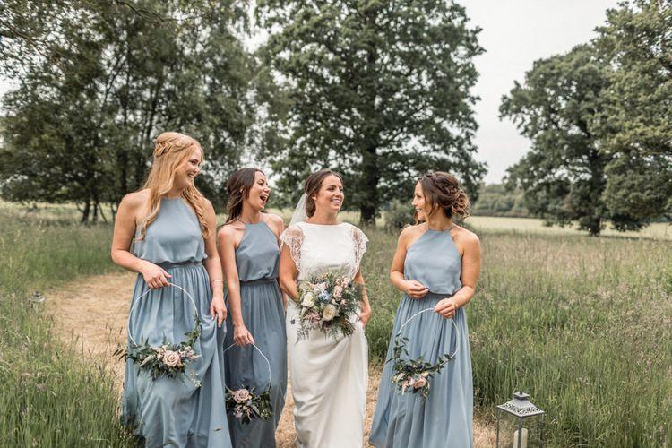 Bride in Charlie Brear Torum Wedding Dress and Bridesmaids in Halterneck Blue JJ's House Dresses with Hoop Bouquets