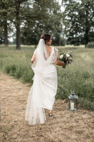 Bride in Charlie Brear Torum Wedding Dress
