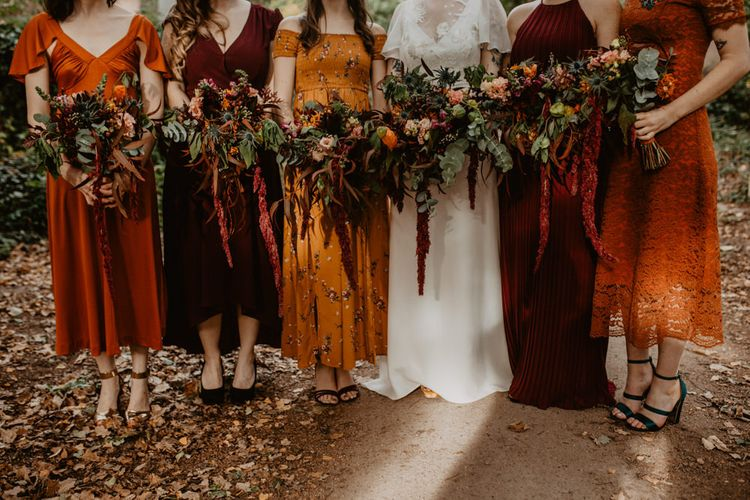 Large Bridal Party Bouquets with Orange and Red Flowers and Foliage