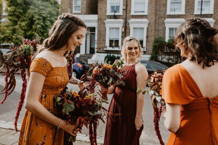 Bridesmaids in Different Burnt Orange Dresses