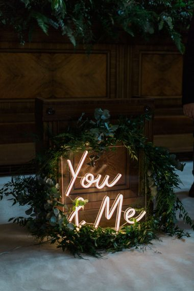 Neon You & Me Sign at Altar | Town Hall Hotel Bethnal Green | Neon Sign and Marine Green Rewritten Bridesmaids Dresses with Lace Cape Grace Loves Lace Gown | Alain Mbouche Photography