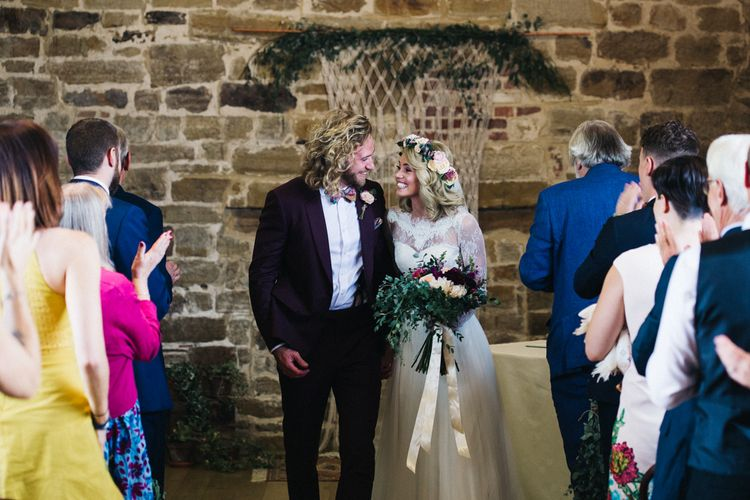 Wedding Ceremony with Bride in Separates and Flower Crown and Groom in Burgundy Suit