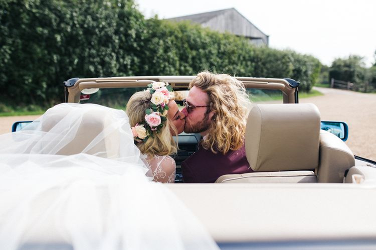 Bride and Groom Kissing in the Wedding Car