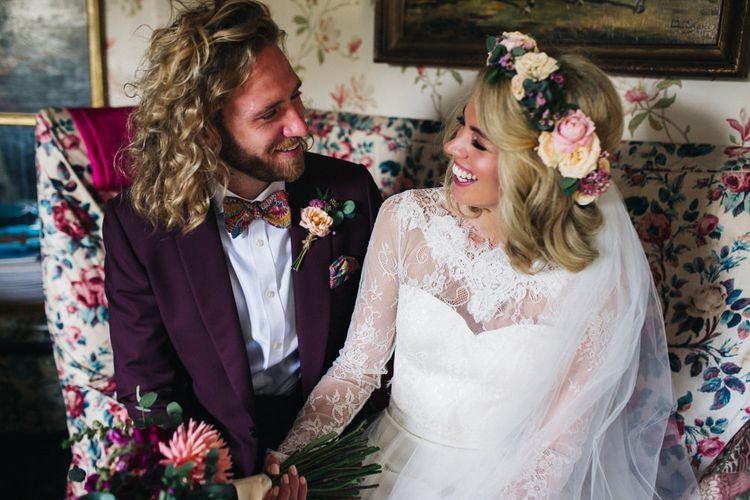 Laughing Bride in Separates and Flower Crown with Groom in Burgundy Suit