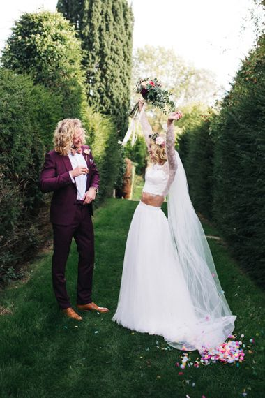 Happy Bride in Separates and Flower Crown and Groom in Burgundy Suit
