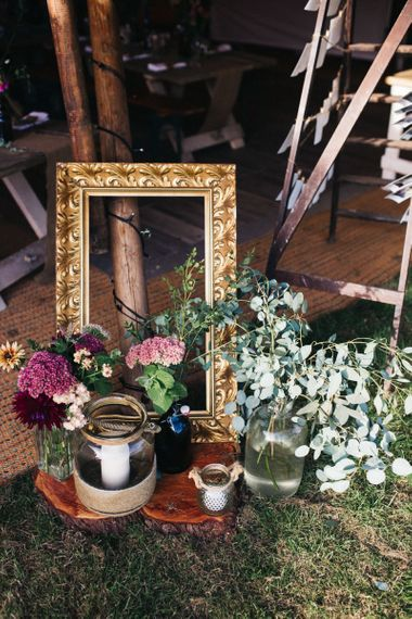 Wedding Decor with Gold Guilt Frame and Flower Stems in Jars