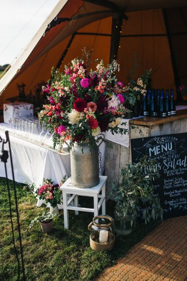 Milk Churn Filled with Pink and Red Wedding Flowers