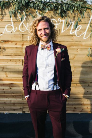Groom in Burgundy Paul Smith Suit and Floral Bow Tie