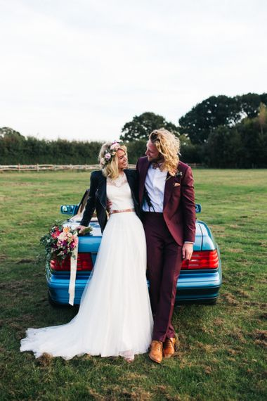 Cool Bride and Groom Hanging Out By Their Wedding Car