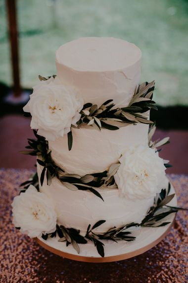 Buttercream Wedding Cake With Fresh Flowers // Image By Olivia Whitbread Roberts Fine Art Photography