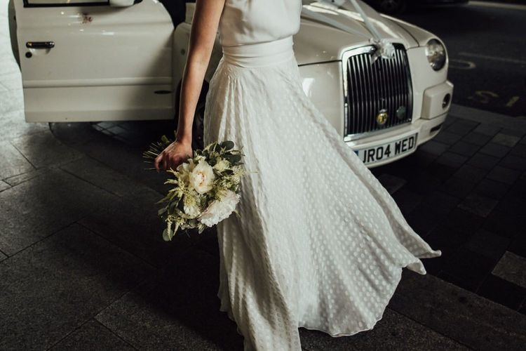 Satin Wedding Dress Polka Dot Overskirt with Manolo Blahnik Wedding Shoes and White Taxi Cab