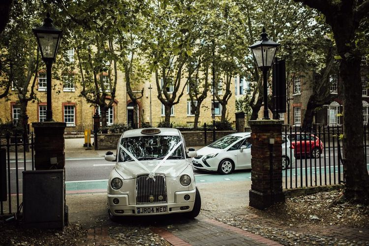 White Taxi Cab with White Ribbon for London City Wedding Day at Registry Office