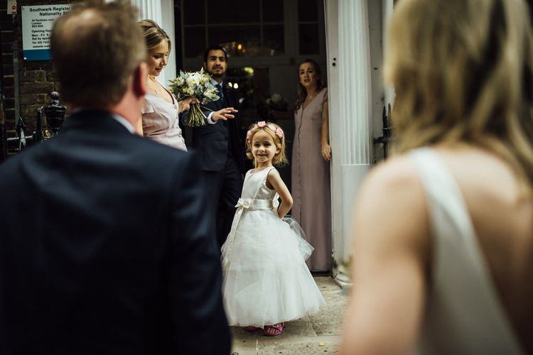 Young Wedding Guest at London City Wedding with Nude Bridesmaid Dresses and White Bouquets