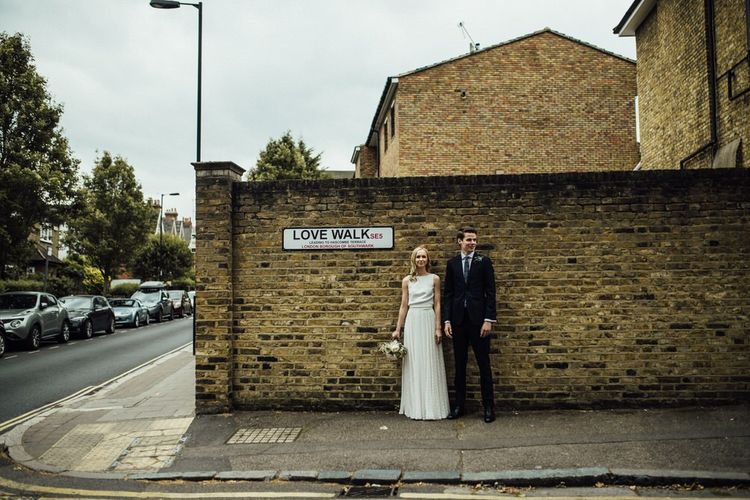 Bride and Groom Summer City London Wedding  with Manolo Blahnik Wedding Shoes and Love Walk Road Sign