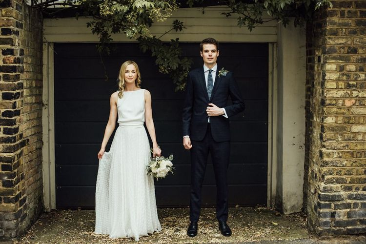Bride and Groom at Urban City Wedding Wearing Elegant Manolo Blahnik Wedding Shoes