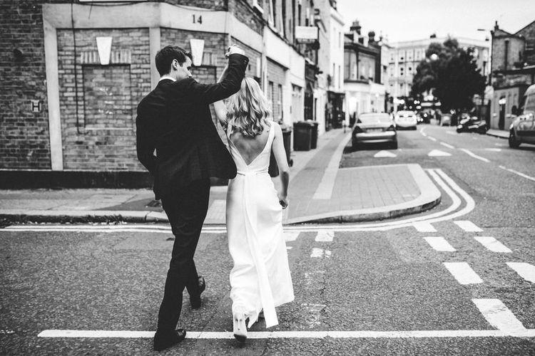Bride and Groom London Shot in Satin Wedding Dress with Manolo Blahnik Wedding Shoes