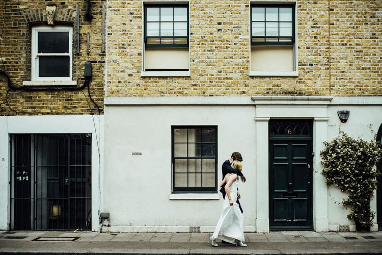 Bride and Groom Embrace for Urban City London Shot with Manolo Blahnik Wedding Shoes