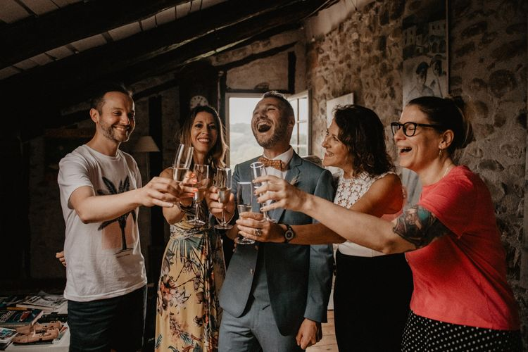 Groom celebrates with guests