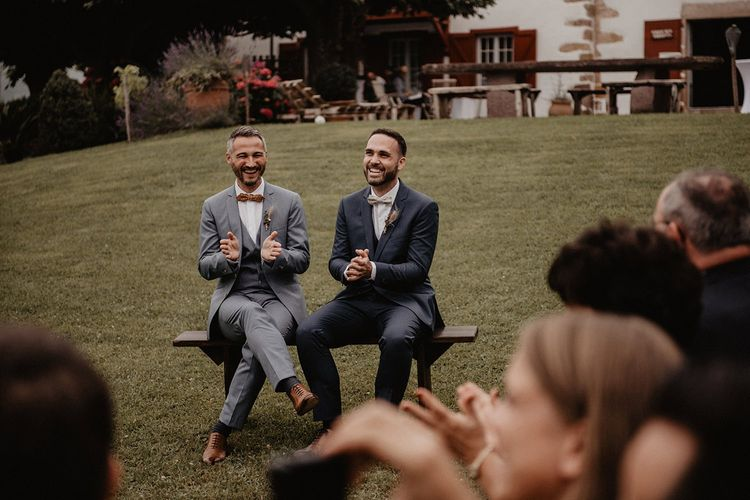 Grooms bow ties and complementing suits