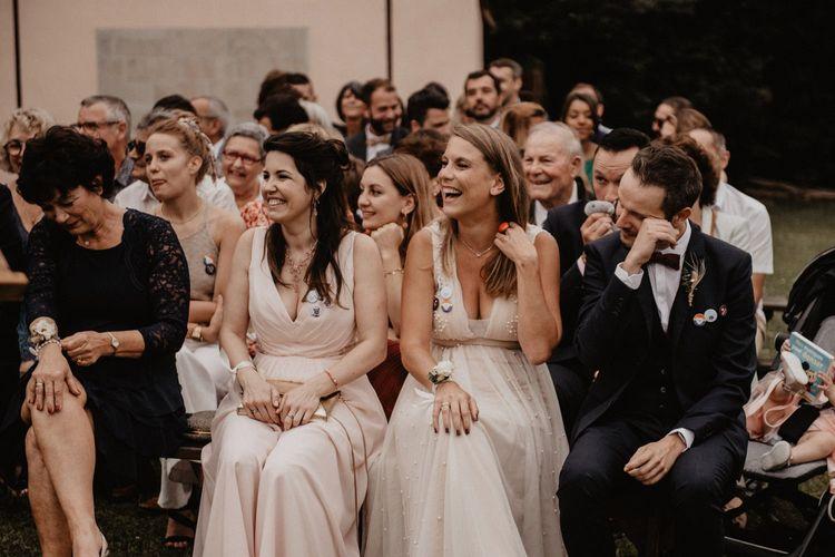 Wedding guests enjoy outdoor ceremony