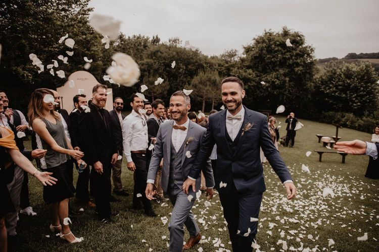 Confetti exit for grooms bow ties and wedding suits