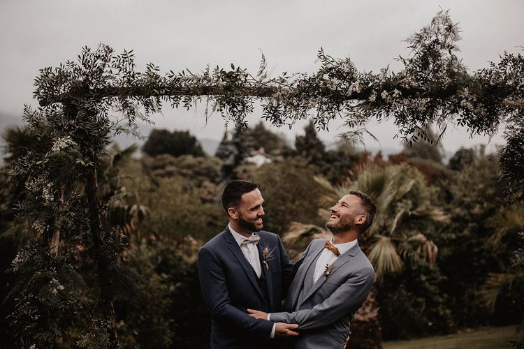 Grooms bow ties and wedding suits