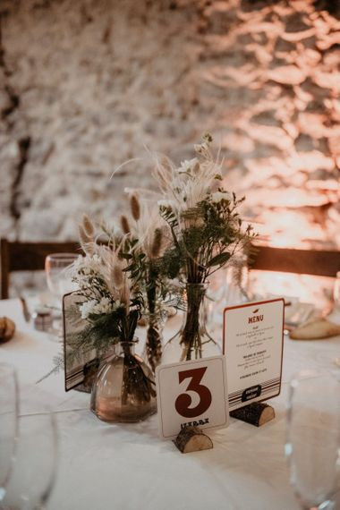 Dried wedding flowers and table decor