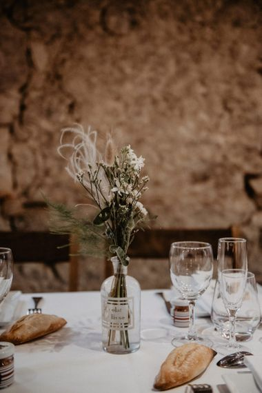 Wedding table decor with dried flowers and grooms bow ties