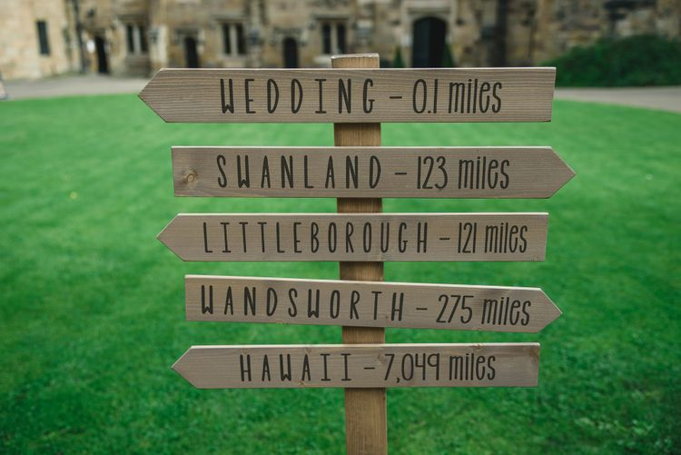 Wooden Sign For Wedding // Choreographed First Dance For Wedding At Durham Castle Wedding With Classic Styling And Bride In Alexander McQueen Images From Stan Seaton