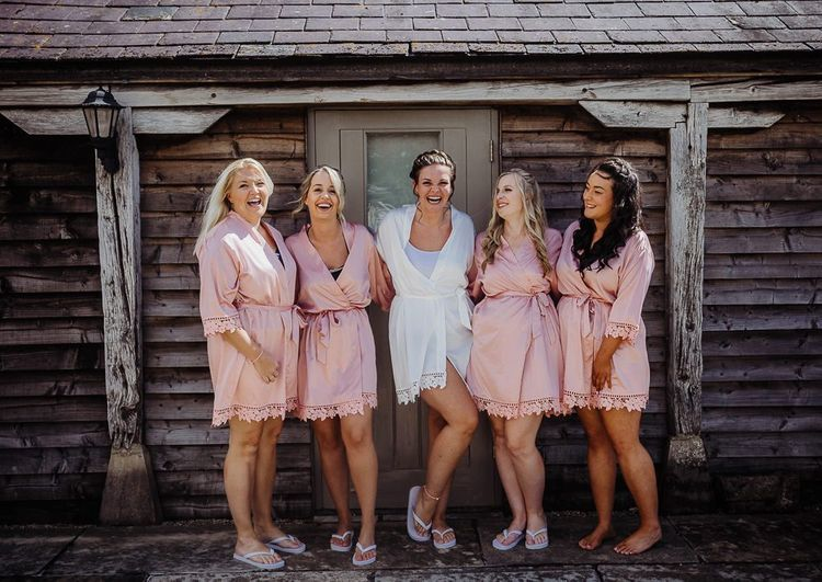 Pink bridesmaid getting ready robes
