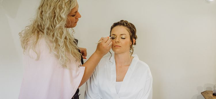 Bridal makeup preparations at Caswell House