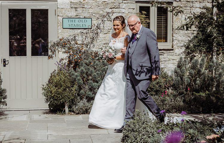 Bride makes her way to wedding ceremony