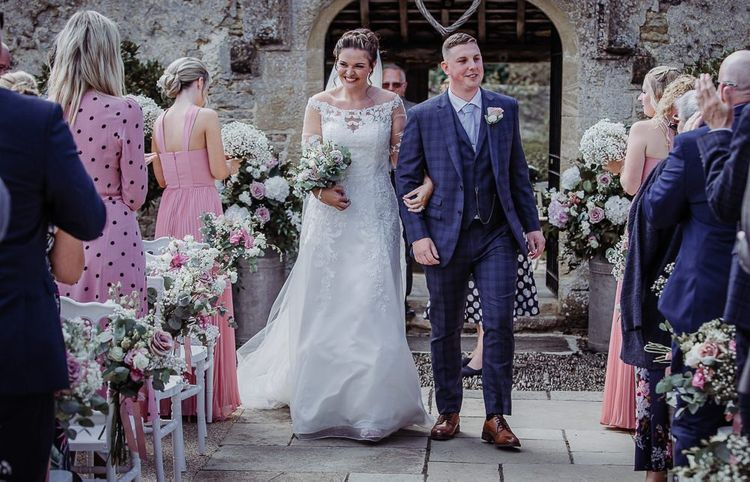 Bride and groom walk down the aisle at outdoor wedding ceremony in Oxfordshire