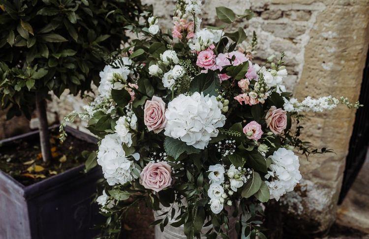 Pink and white wedding flower arrangements