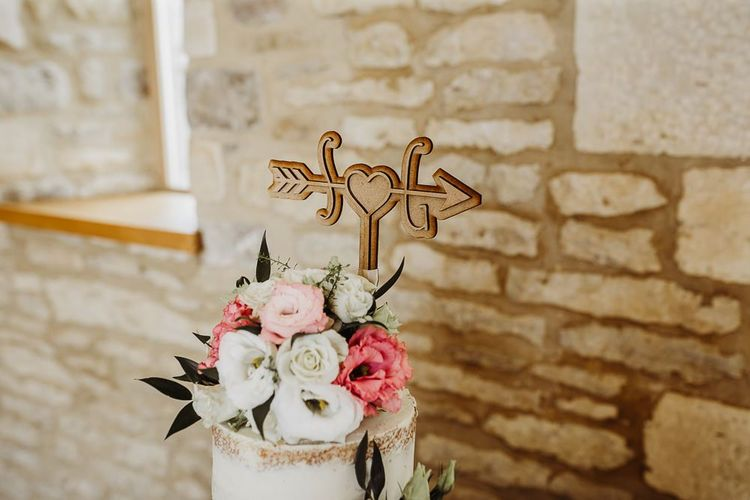 Personalised wooden cake topper at Caswell House
