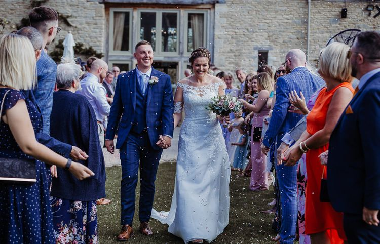 Confetti moment at Caswell House for bride and groom