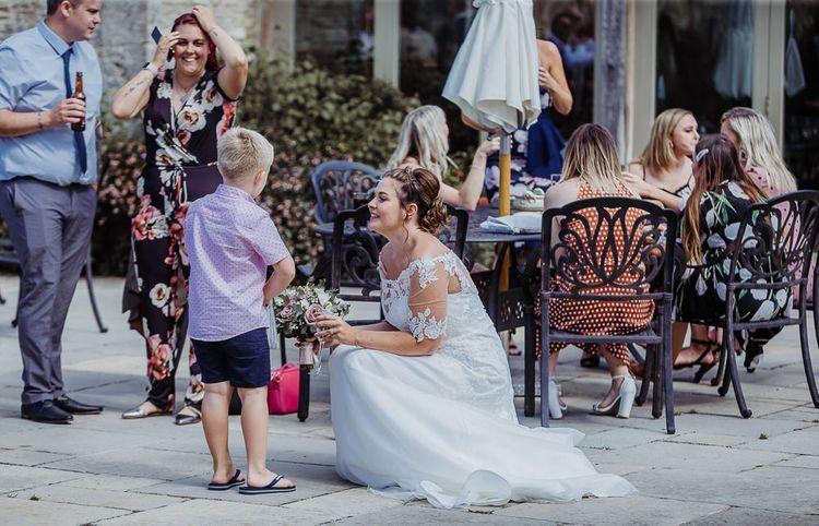 Bride speaks to wedding guests