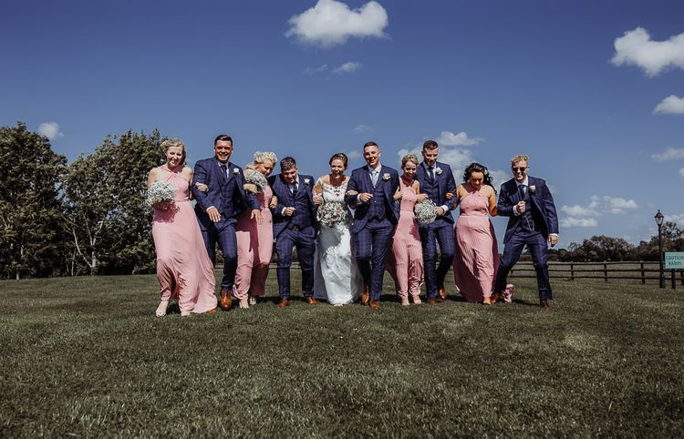 Bridesmaids in pink dresses with groomsmen