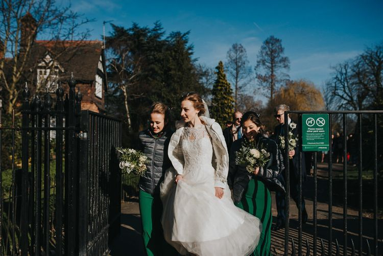 Bridal Party Wear Puffer Jackets // Winter Wedding at The West Reservoir Centre, Stoke Newington | Bride wears Maggie Sottero Dress | Bridesmaids in ASOS | Images by Remain In Light