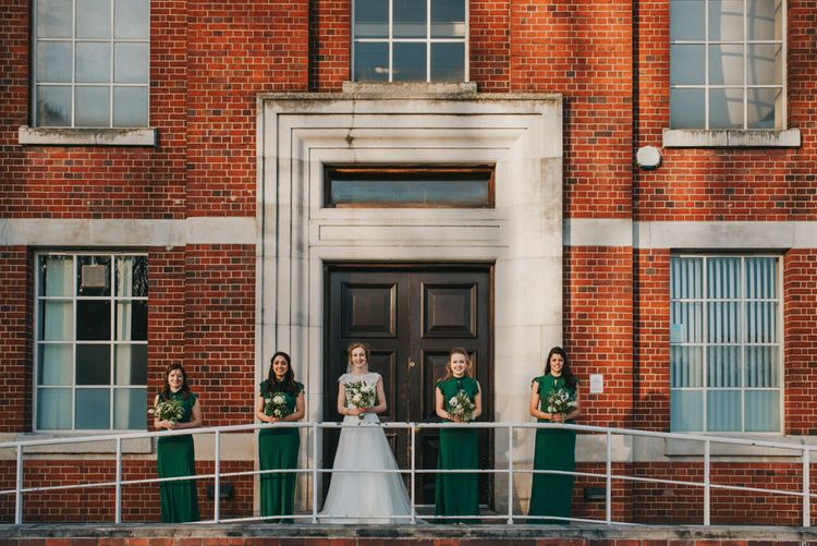 Bride and Bridesmaids in ASOS Green Dresses Outside The West Reservoir Centre, Stoke Newington // Images by Remain In Light