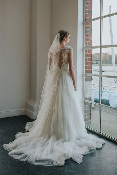 Bride wears Maggie Sottero Dress with Keyhole Back  // Images by Remain In Light