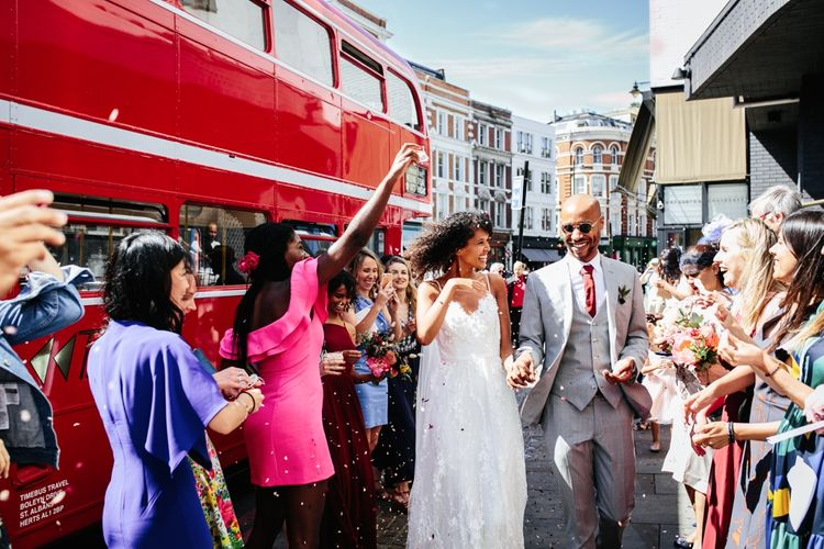 Red Routemaster Bus Wedding Transport // Stylish Rooftop Wedding At Ace Hotel Shoreditch // Image By Story Wedding Photography // Bride In Catherine Deane // Bobbi Brown Bridal