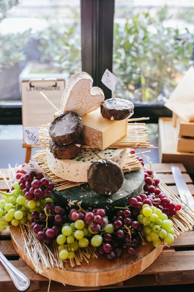 Cheese Tower For Wedding // Stylish Rooftop Wedding At Ace Hotel Shoreditch // Image By Story Wedding Photography // Bride In Catherine Deane // Bobbi Brown Bridal