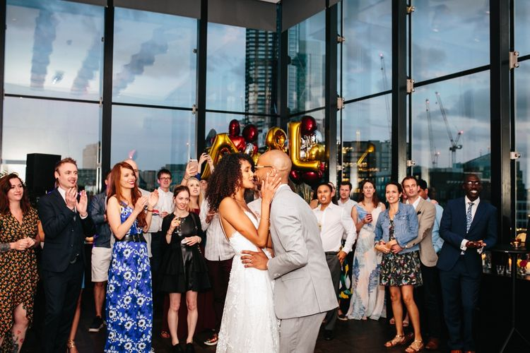Stylish Rooftop Wedding At Ace Hotel Shoreditch // Image By Story Wedding Photography // Bride In Catherine Deane // Bobbi Brown Bridal