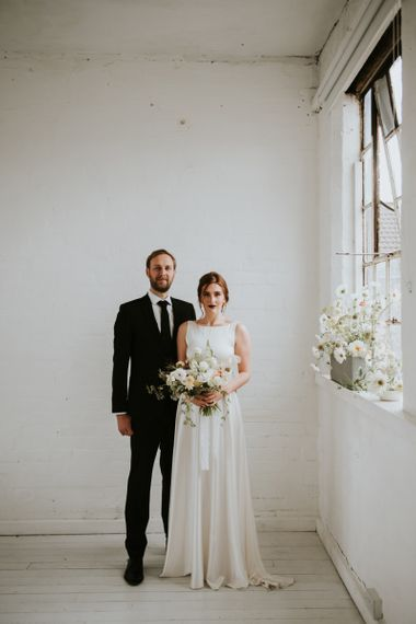 Bride and groom in timeless wedding outfits for minimalism wedding inspiration