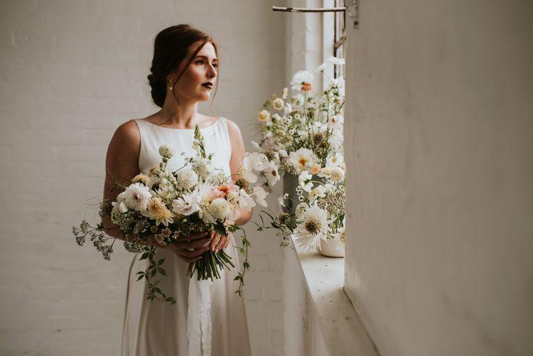 white and pale lemon wedding bouquet and floral arrangement for minimalism wedding